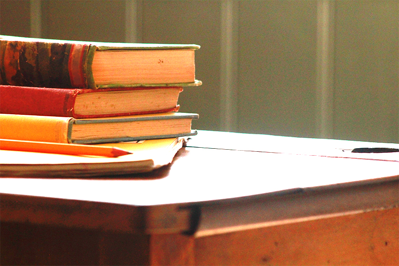 stack of books on a desk